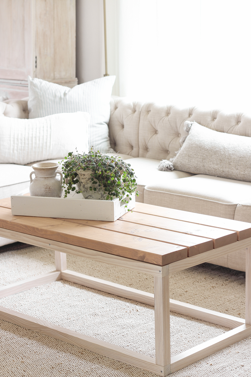 Home and lifestyle blogger Liz Fourez shares the new coffee table she built for her living room with a full tutorial and step-by-step photos. Read this blog post for more details!