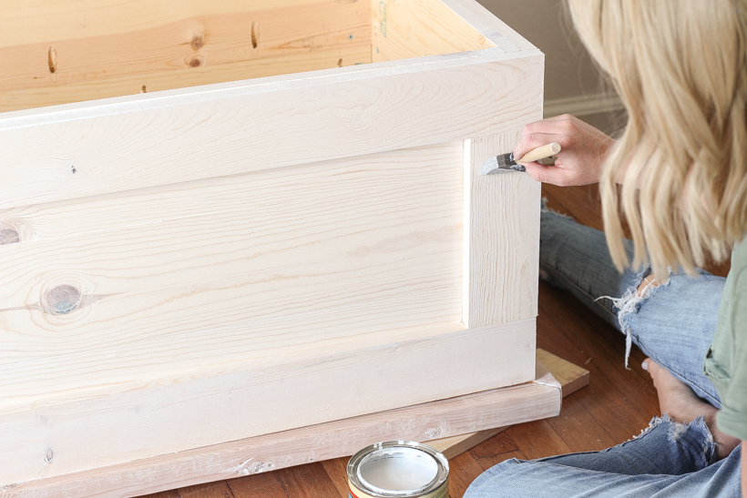 DIY plans and tutorial for a beautiful wood storage trunk with step-by-step photos