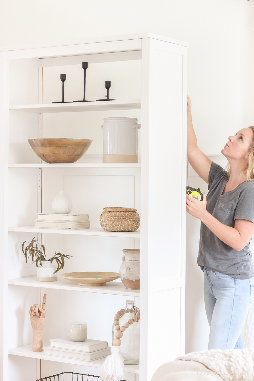 Use this one simple trick to upgrade your IKEA bookshelf for a more high end look! You'll be so glad you did. Tutorial at LoveGrowsWild.com