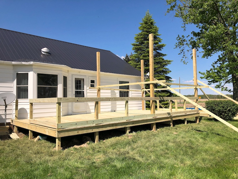 Progression of creating an outdoor living space with a large deck and gazebo