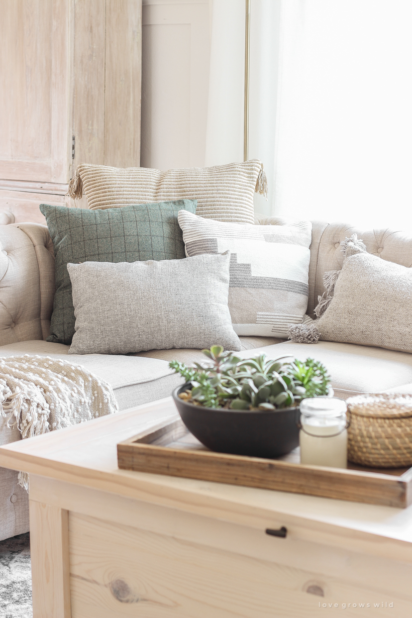 A warm and cozy living room with lots of layers, texture and pattern for fall