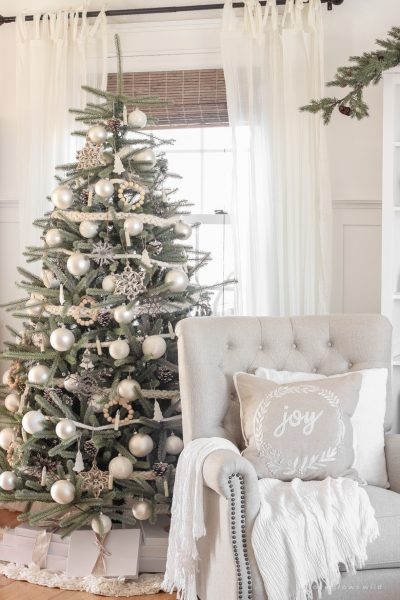 A peek inside home blogger Liz Fourez's farmhouse living room all decorated for Christmas