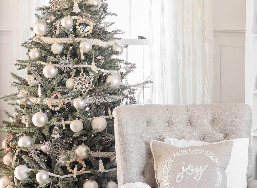 A peek inside home blogger Liz Fourez's farmhouse living room all decorated for Christmas