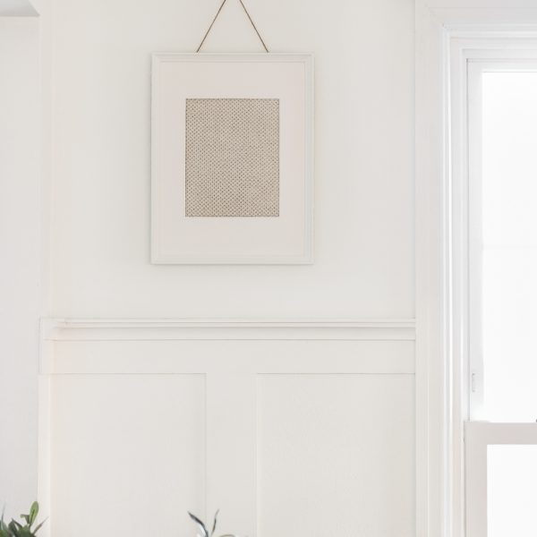 Decorating tip: Frame a scrap piece of fabric for a simple and inexpensive piece of artwork. Home + lifestyle blogger Liz Fourez shares her advice for the best fabric options to use.