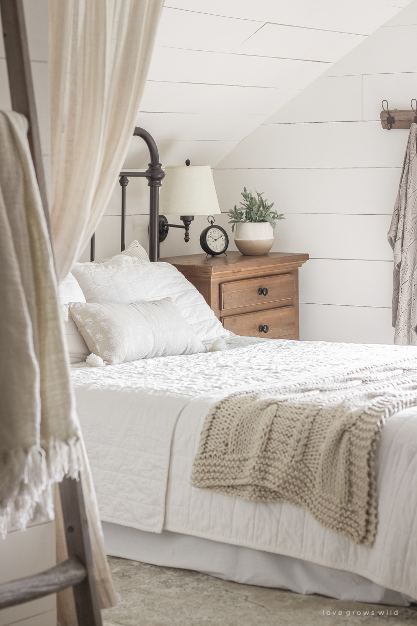 A new rug, curtains, bedding and artwork in designer Liz Fourez's beautifully cozy master bedroom