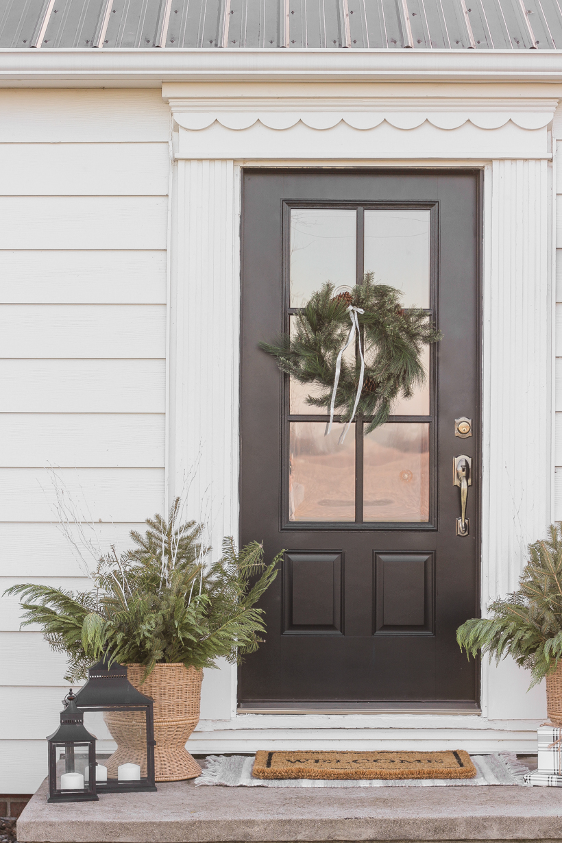 Interior decorator and home blogger Liz Fourez shares how to make these beautiful winter planters for the holidays with fresh or faux greens!