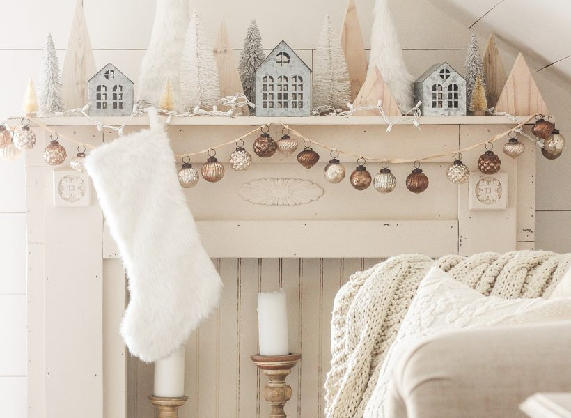 Interior decorator and home blogger Liz Fourez shares her beautiful mantel decorated for Christmas. Find out how you can build this exact mantel on LoveGrowsWild.com