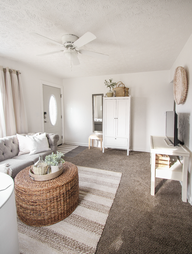 A small rental home decorated in a cozy beachy cottage style on a budget! Get all the details from home blogger and interior decorator Liz Fourez of lovegrowswild.com