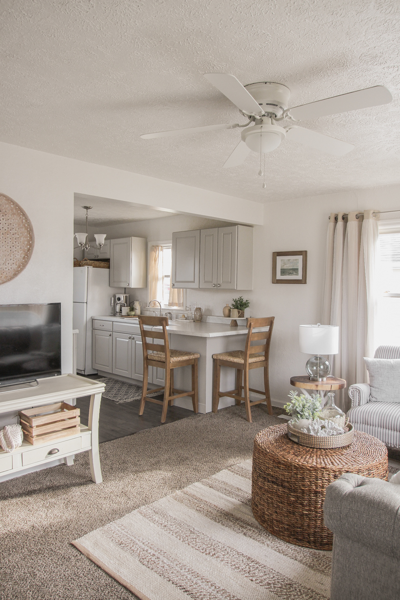A small rental home decorated in a cozy beachy cottage style on a budget! Get all the details from home blogger and interior decorator Liz Fourez