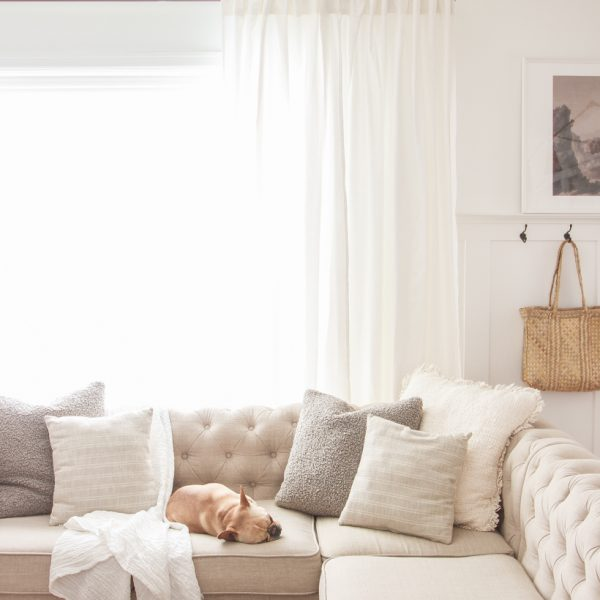 The best way to hang curtains to make your windows appear larger and more luxurious! See tips from home blogger and interior decorator Liz Fourez of LoveGrowsWild.com