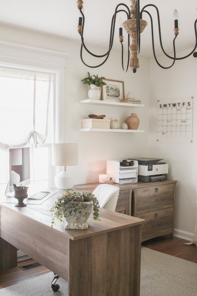 Home blogger and interior decorator Liz Fourez shares her home office that features antique furniture as the perfect storage pieces for her business.