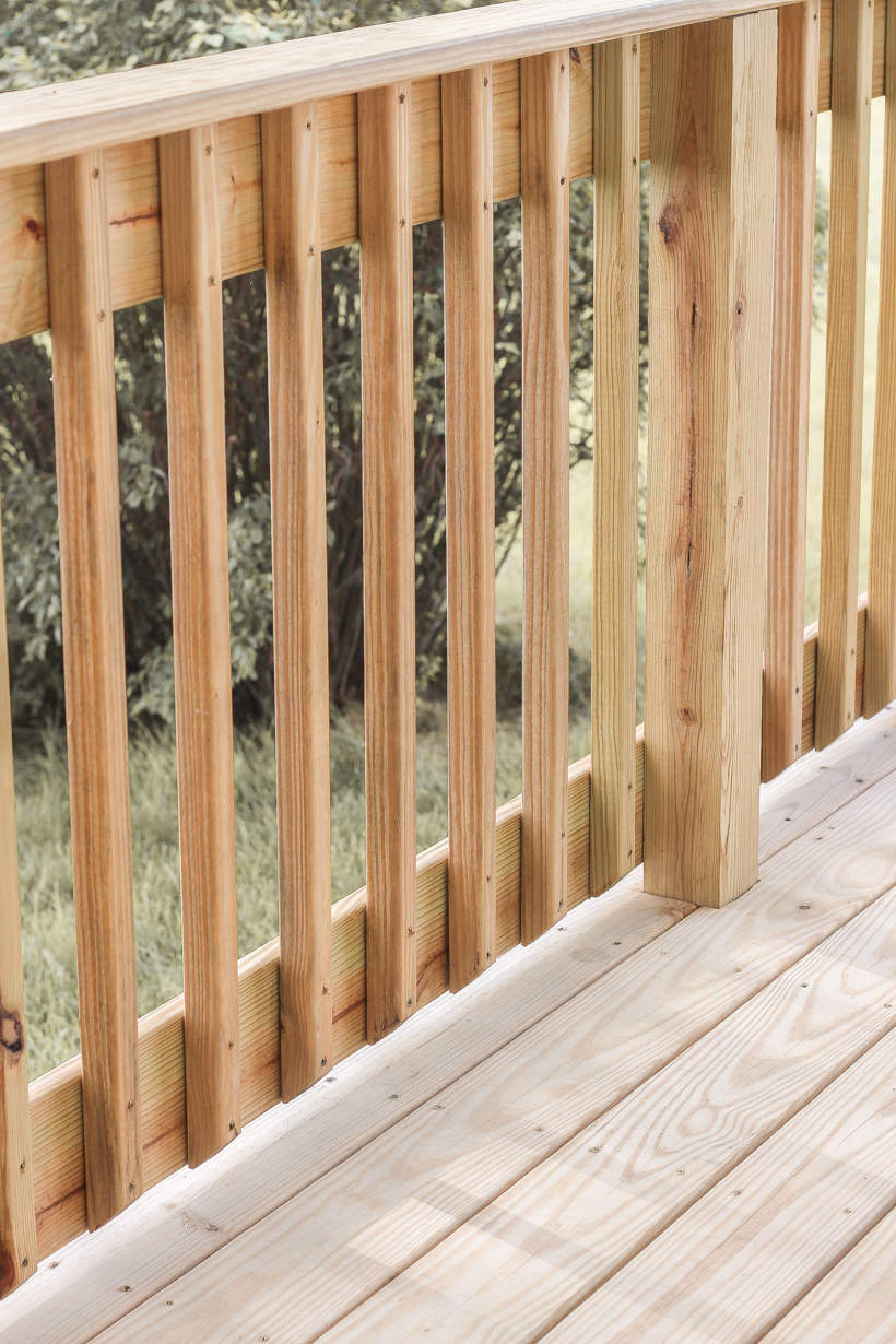 Interior decorator and home blogger Liz Fourez shares everything you need to know about staining a deck from prep to finish!