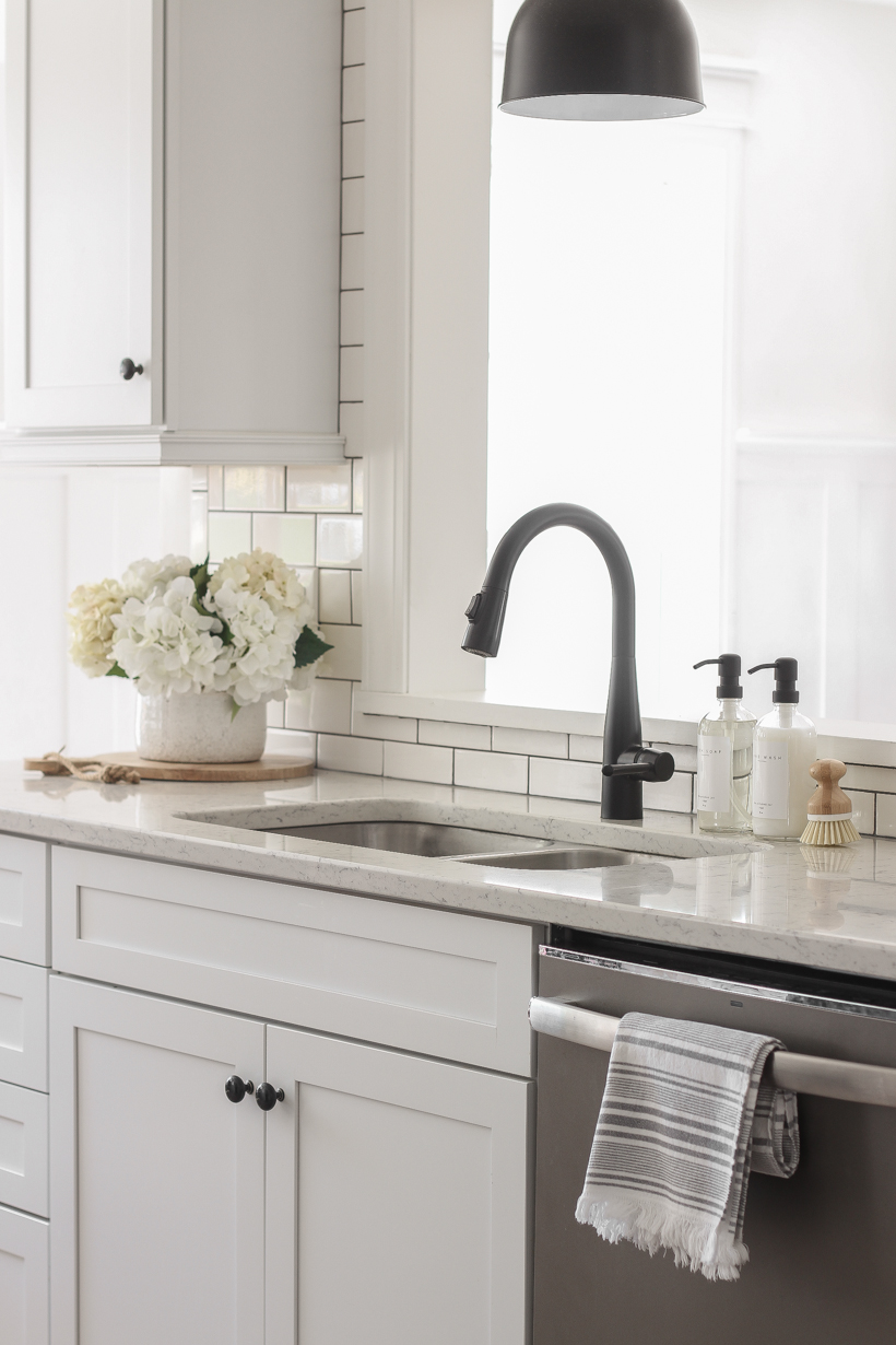 One Simple Way to Style Your Sink | Home blogger and interior decorator Liz Fourez shares tips for easily elevating your kitchen and bathroom