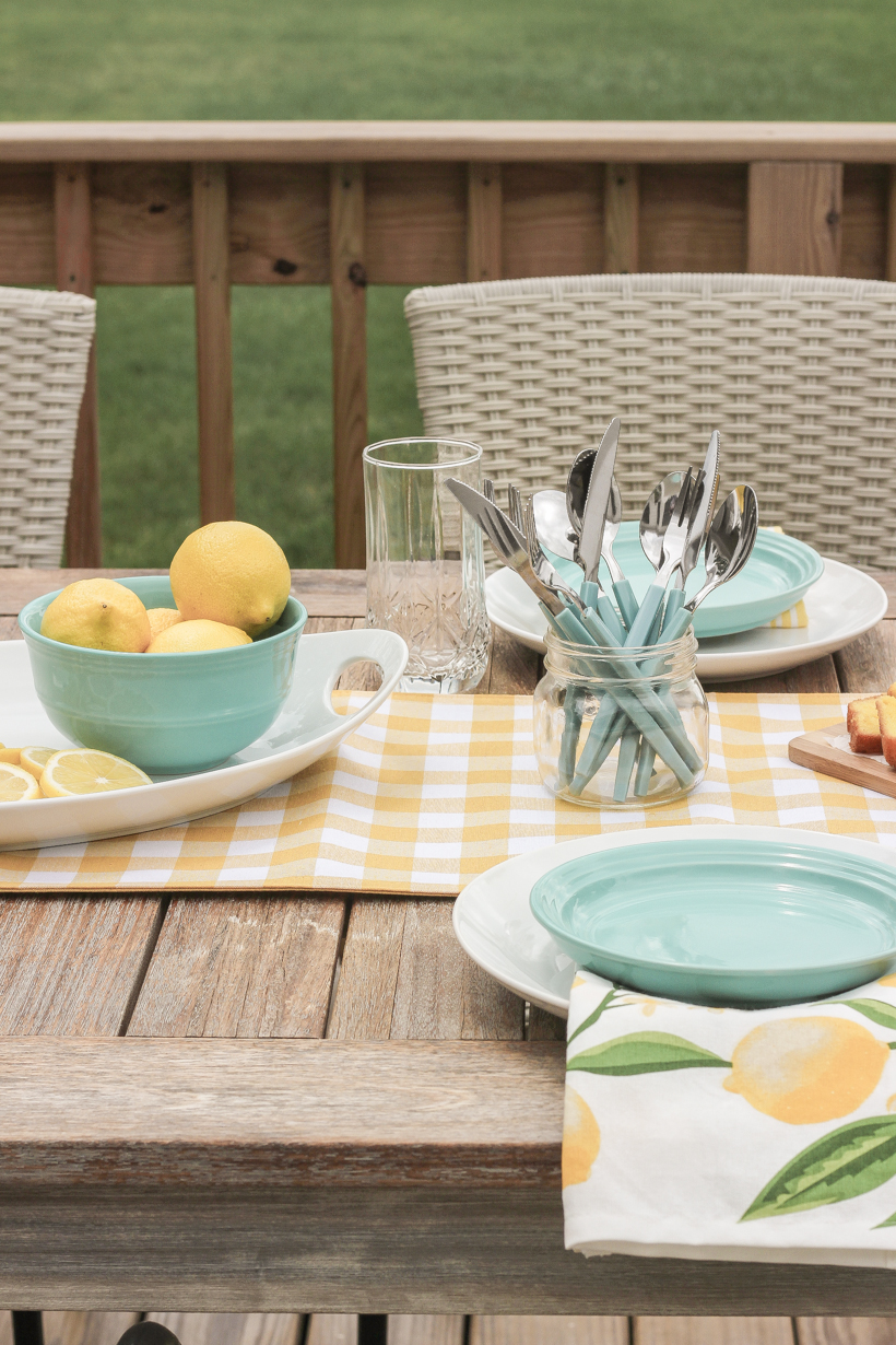 Designer and blogger Liz Fourez shows how to put together a simple, but charming lemon inspired table setting for summer.