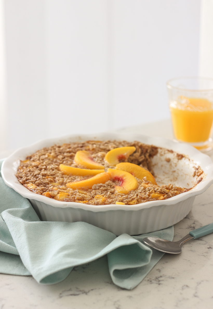 Blogger Liz Fourez of LoveGrowsWild.com shares a delicious peach baked oatmeal that is perfect for brunch or prepping a healthy breakfast for the week ahead.