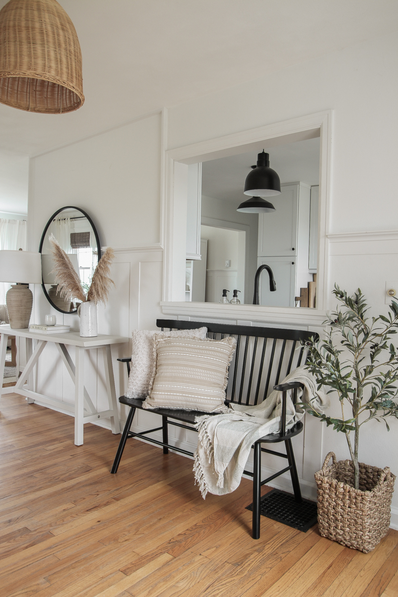 A beautiful neutral entryway shared by home blogger and interior decorator Liz Fourez