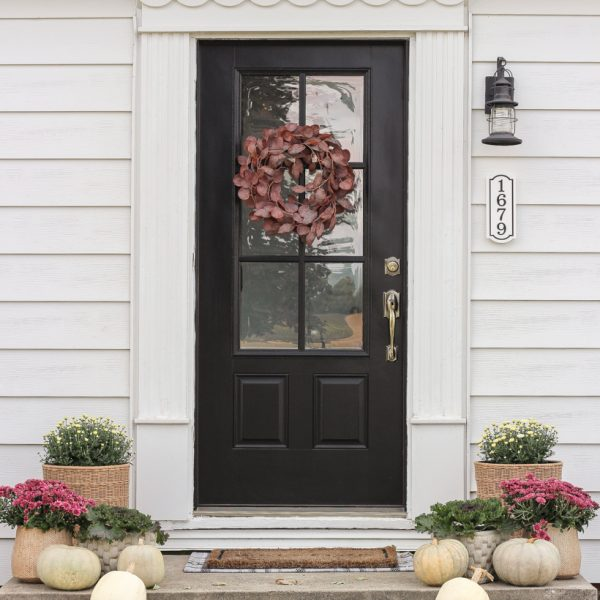 Home blogger and interior decorator Liz Fourez shares her small front porch decorated for fall with the perfect mix of soft neutrals and subtle color.