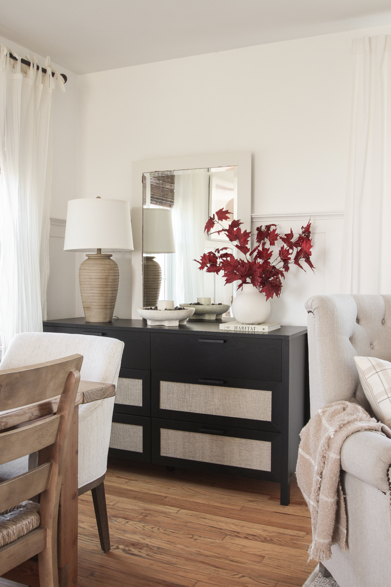 Home blogger and interior decorator Liz Fourez shares a beautiful fall vignette in her dining room featuring deep red fall branches and a new furniture find that has a high-end look without the high-end price